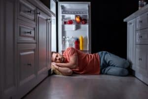 With the current rising of temperatures, the man sleeping on the fridge symbolize the ease from heat and bed bugs from his bed.